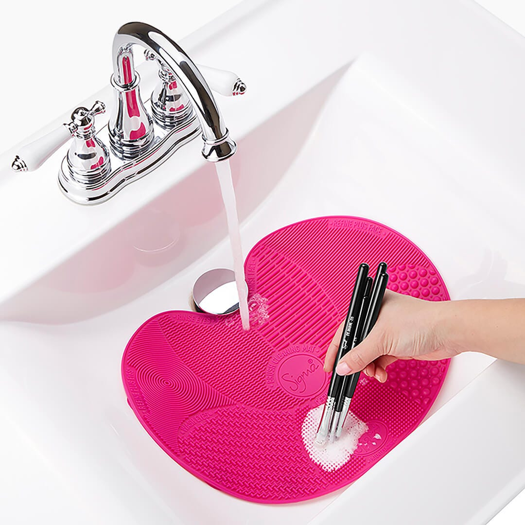Sigma Spa® Makeup Brush Cleaning Mat placed in sink
