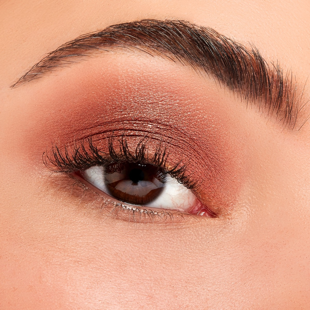 A closeup of a woman's eye with Sigma's Earthen Eyeshadow Base Primer with Iconic Eyeshadow